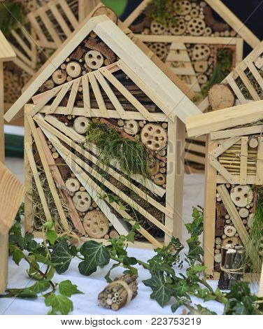 Wooden hotel for insects Decorative house Closeup