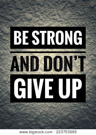 Motivational and inspirational quotes - Be strong and don't give up. With vintage styled background.