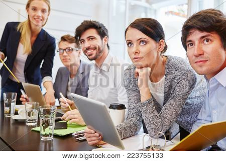 Group of people in a business meeting as a team cooperating