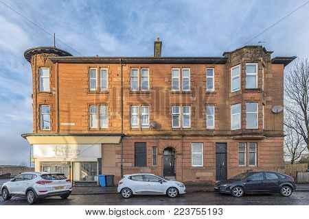 CLYDEBANK, SCOTLAND - JANUARY 20, 2018: A red sandstone tenement at the bottom end of Whitecrook street in Clydebank.