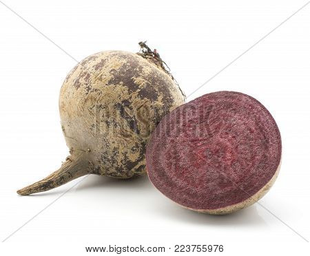 One beetroot bulb and a half (raw red beet) isolated on white background