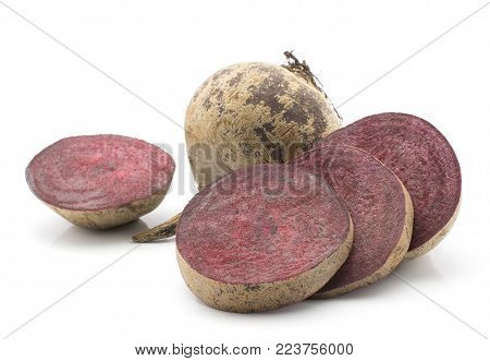 Beetroot (raw red beet) one bulb and four sliced rings isolated on white background