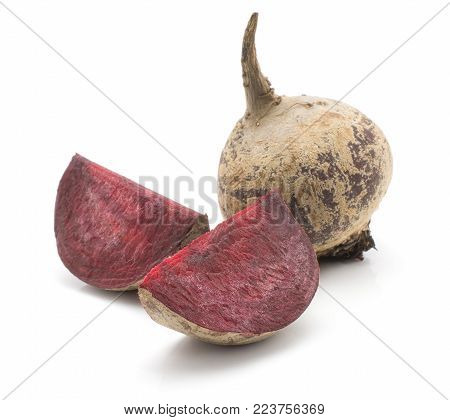 One beetroot bulb and two slices (raw red beet) isolated on white background