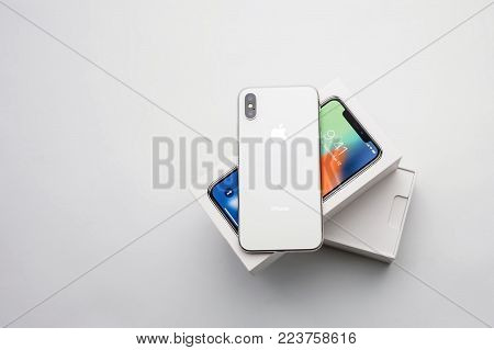 KYIV, UKRAINE - 26 JANUARY, 2018: New Iphone X smartphone model close up. Newest Apple Iphone 10 mobile phone device on white branded Apple box on white table in store