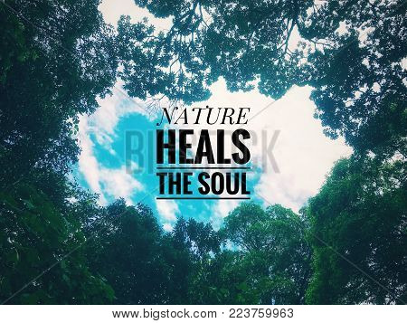 Nature awareness concept with wordings Nature heals the soul. With vintage styled background.