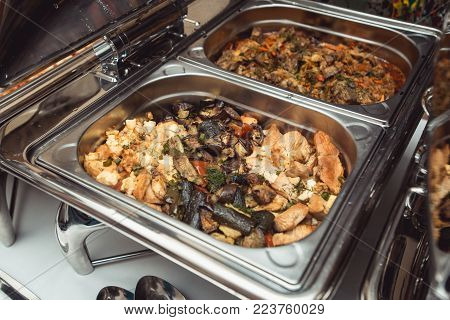 Wedding Catering: Chicken with Vegetables and Gravy in a steel Chafing Dish.