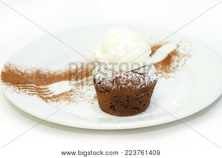 Chocolate fondant with homemade ice cream. A trace from a fork on a chocolate chip
