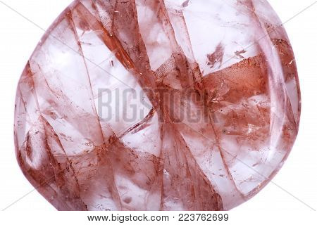 Polished quartz flat palm stone with red hematite inclusions from Madagascar