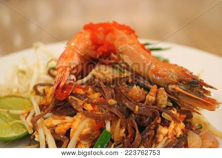 Plate of Pad Thai or Thai Style Stir-fried Noodle Topped with Whole Prawn