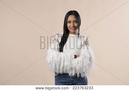 young latina arabic girl smiling isolated on studio background