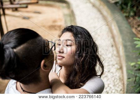 Young Asian Couple Enjoying an Intimate Moment