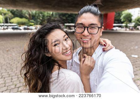Asian Couple Taking a Selfie