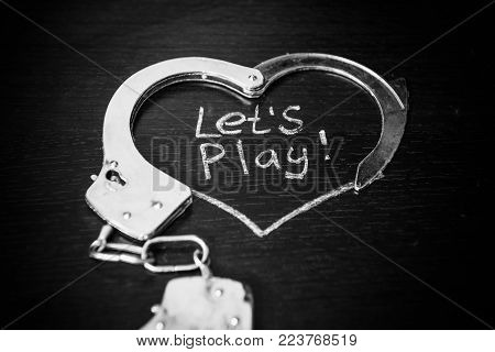 Lets Play Bdsm. Handcuffs For Role-playing. Adult Game Concept. Handcuffs Like Heart With Caption On