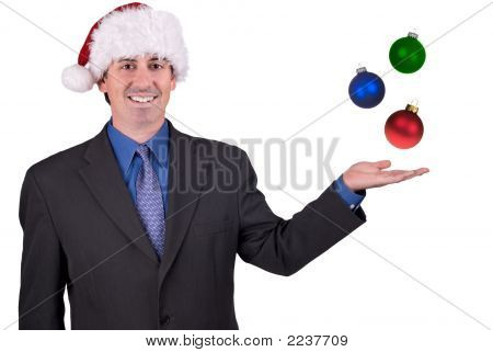 Businessman With Ornaments And Santa Hat