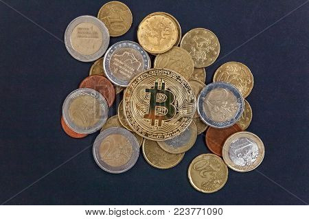 Physical version of Bitcoin, new virtual money . Golden symbolic coins of bitcoins on Euro coins. Exchange bitcoin. Concept worldwide cryptocurrency.