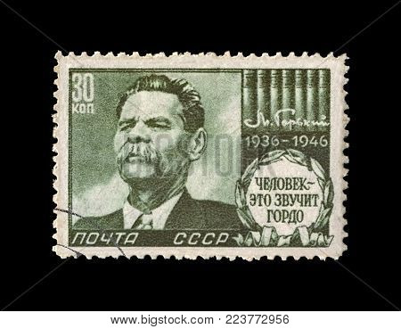 USSR - CIRCA 1946: canceled stamp printed in the USSR (Soviet Union) shows Maxim Gorky aka Alexei Maximovich Peshkov (1868-1936), famous Russian writer, dramatist, politician, circa 1946. vintage postal stamp isolated on black background.