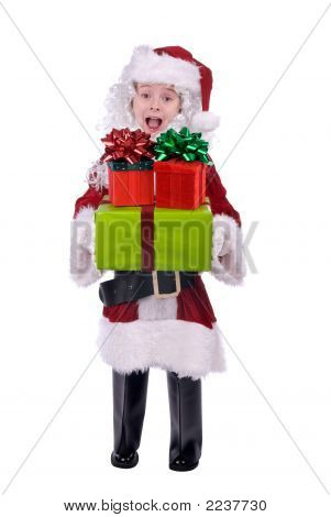Boy In Santa Suit With Gifts