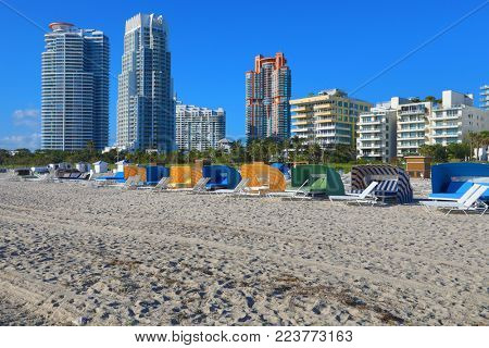 Cabanas and chairs line the beach in Miami Beach in the South Beach art deco district of this Florida city