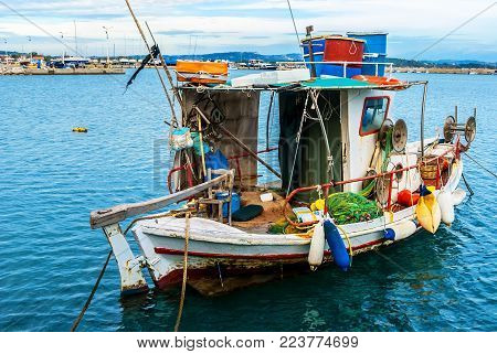 Small traditional fishing boat, floating in the Mediteranean sea, Greece in a beautifull afternoon.