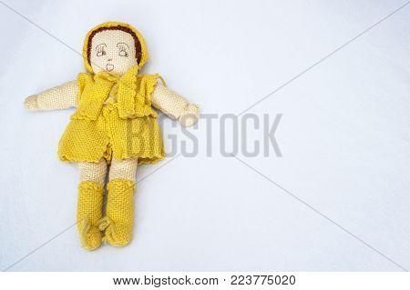 Hand knit yarn doll on white background