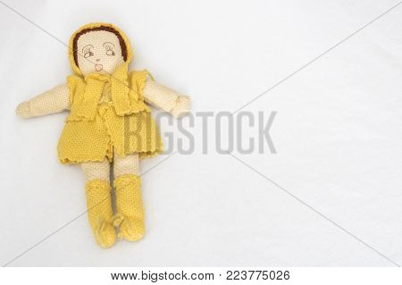 Hand knit vintage yard doll on white background