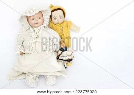 Three antique and vintage dolls on white background