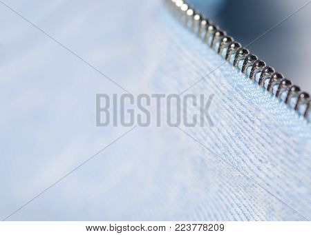 Blue white fabric clothes zipper shirt macro blurred background