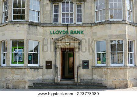 BOURTON ON THE WATER, UK - JUNE 21, 2017: Outside Lloyds bank on the main high street, Bourton on the water, Gloucestershire, UK