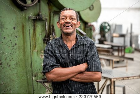 Portrait of Worker on Factory on background