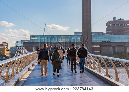 LONDON, UNITED KINGDOM - NOVEMBER 06: View of the famous Millenium Bridge with the Tate museum in the background on November 06, 2017 in London