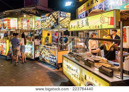 TAIPEI, TAIWAN - MAY 20: Street food vendors in the famous Shilin night market, a popular travel destination in Taipei on May 20, 2017 in Taipei