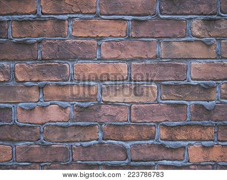 Classic country home brick wall with dripping mortar, background photograph.