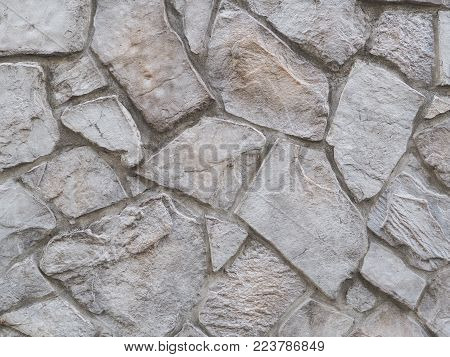 Paved large stones background photograph, rough 3D texture. Grey stone wall, authentic photograph shot outdoors with natural light. Japanese style rough and natural 3D texture arrangement.