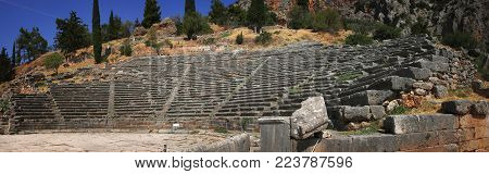 Panoramic view of the ancient theater in the famous archaeological site of Delphi which was believed during the antiquity to be