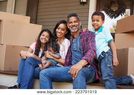 Family With Children Outside House On Moving Day
