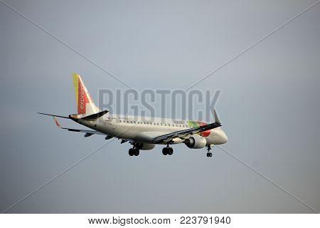 Amsterdam the Netherlands - January 14th 2018: CS-TPR TAP Express Embraer ERJ-190 approaching Schiphol Amsterdam Airport Polderbaan runway