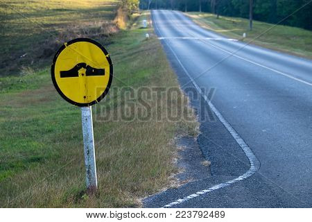 Speed bump traffic sign on blue sky background with clipping path included