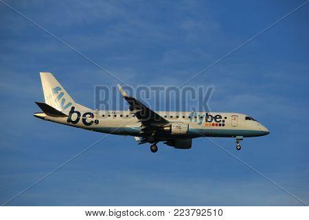 Amsterdam the Netherlands - July 7th 2017: G-FBJD Flybe Embraer ERJ-175 approaching Schiphol Amsterdam Airport Polderbaan runway