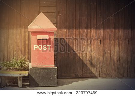 Postbox In Front Of Rows Of Old Wooden House,vintage Filter.