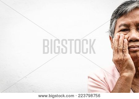 close up asian old woman hiding face with her hands
