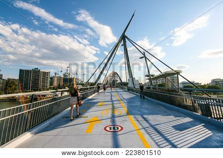 BRISBANE, AUSTRALIA - OCTOBER 09, 2012 : People are walking on Goodwill Bridge from Queensland University of Technology (QUT) to South Bank