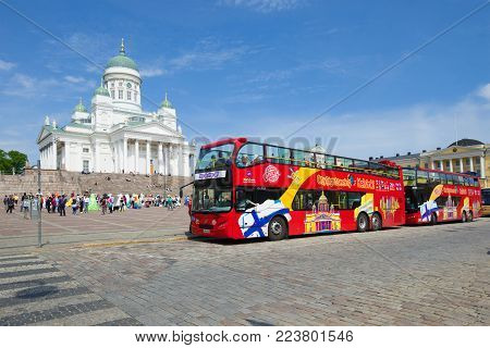 HELSINKI, FINLAND - JUNE 11, 2017: Two Hop On Hop Off tour bus on Senate Square on a sunny June day