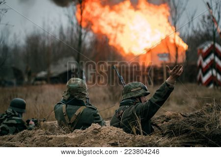 Gomel, Belarus - November 26, 2017: The Wehrmacht soldiers in the trenches are protected from the attack of the Red Army