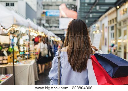 Young woman with shopping bags walking and shopping in the shop, Woman lifestyle concept