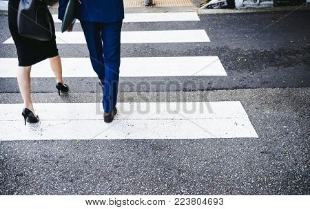 People crossing a city road