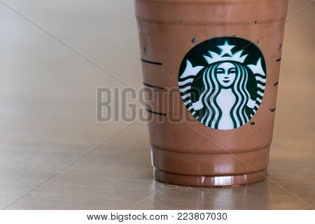 Ayutthaya, Thailand - DECEMBER 26, 2017 - Starbucks cold chocolate drink with whip cream in plastic cup. This is the largest coffee chain store.