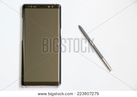 BANGKOK, THAILAND - December 23, 2017 : Samsung Galaxy Note 8 with stylus on white background. It is the flagship smartphone with android os.