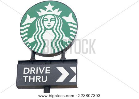 Ayutthaya, Thailand - DECEMBER 26, 2017 - Starbucks logo with drive thru banner on white sky background. Starbucks is the largest coffee chain store.