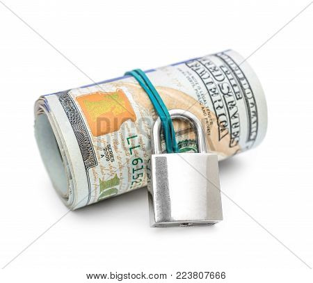 Rolled up dollar bills with padlock on white background. Protection money concept.