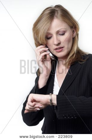 Lady Talking On Cell Phone Checking Her Watch